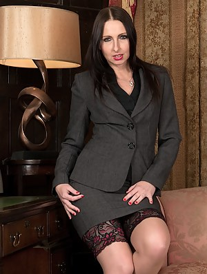 Office cougar Tracey Lain naked in stockings and heels.