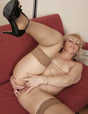 Horny blonde housewife playing on the couch