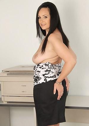 Office MILF Ria Black takes a nreak to massage her mature bangers
