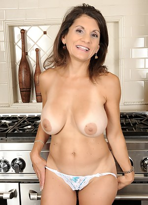 Tori Baker spreading her mature 48 year old ass by the kitchen sink