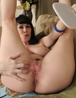 Sexy brunette RayVeness stuffs her panties into her 40 year old pussy