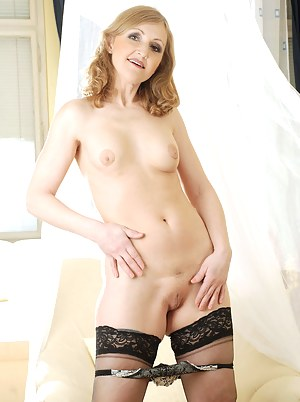 Alluring Anilos woman takes off her panties and slips her talented fingers deep into her snatch