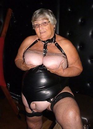 Black PVC, red high heels and chains for Grandma as I get all submissive in the dungeon.  Waitinmg to be fucked as I am