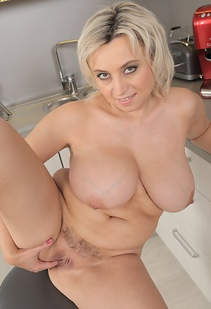 Busty blonde 44 year old Sindy Huga gets naked while making dinner