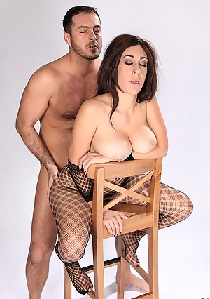 Beautiful lady wearing sexy black fishnet is giving her partner sex lessons. She is tasting his cock and balls before getting drilled hard.