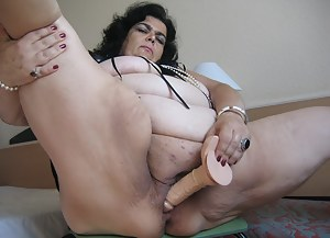 Mature Margarita loves playing with her toys