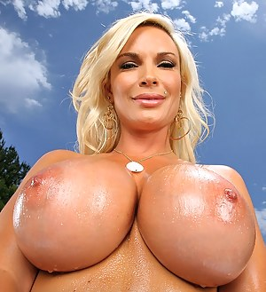 Oiled big tits and fantastic ass of a wet MILF in beautiful bikini revealed in close up during an astonishing outdoor intercourse.