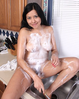 Exotic cutie CiCi Jones soaps herself up at the sink and flashes those boobies