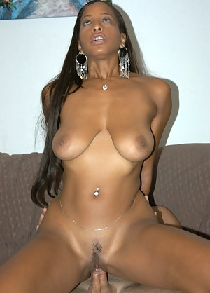 Oiled big tits and wet pussy of a stunning Ebony model in a smoking hot bikini revealed during a fascinating fuck and posing session.
