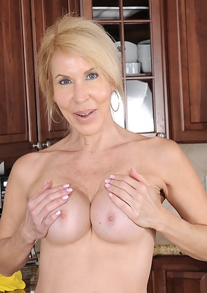 Cute 60 year old Erica Lauren hoses her pussy down in the kitchen