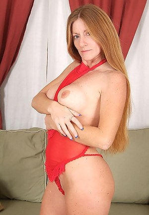 Redheaded MILF in red lingerie wows us with her body