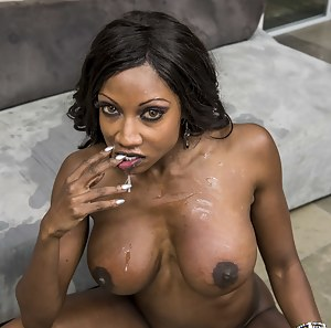 Busty ebony MILF lets this guy in, she even talk to him for a big before deepthroating his massive cock and letting him blow his load all over her.