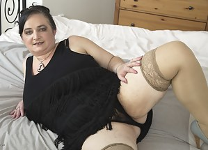 Huge breasted mature BBW playing alone