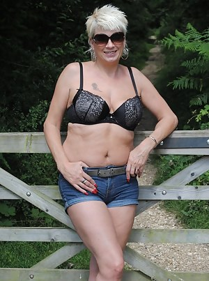 Pictures of  Dimonty in the park and stripping in her hotel room.