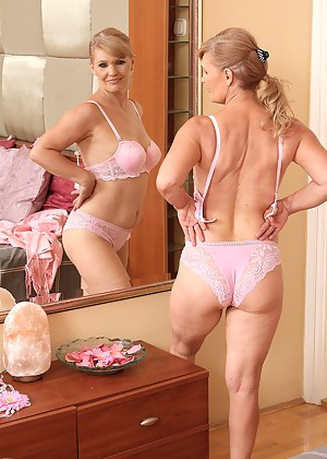 57 year old lena F in sexy pink lingerie spreads her legs on the bed