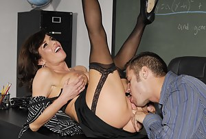 Stockings-clad busty brunette MILF gets banged by this teacher, she probably came here to chat him up a little, not take his load on her face.