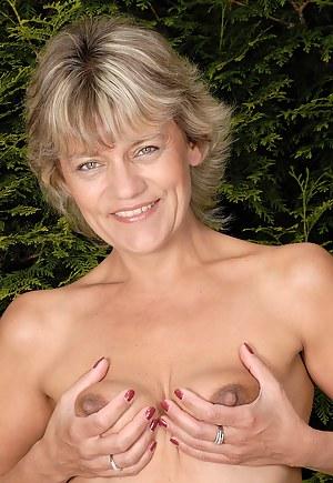 45 year old blonde housewife Sherry D enjoying her backyard naked