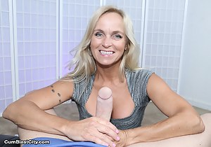 Horny mature lady Dani Dare strokes monster-sized prick with both hands asking for a big pop