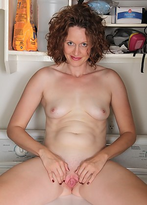 35 year old housewife Roxanne Clemmens gets naked doing laundry