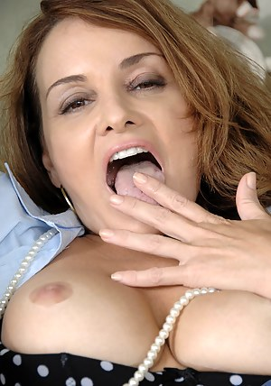 Busty cougar Rebecca Bardoux makes her finger moist and slides it in her hot pussy