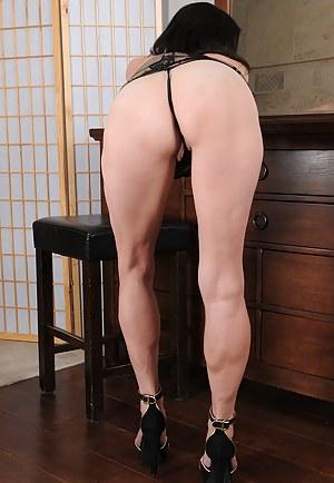 Elegant MILF Maggie K relaxes in her boudoir in her sheet slip, flashing and playing
