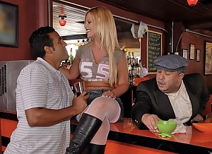 Horny woman wearing black boots and white stockings is enjoying wild sex in the bar. Her lover is penetrating this drunk blonde's holes hard.