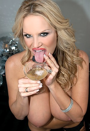 Kelly rings in the New Year with a cum filled cup of champagne.