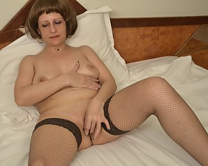 Horny mature slut playing with her wet cunt