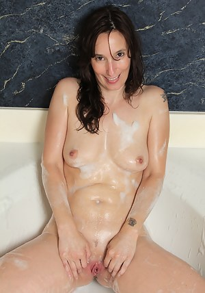41 year old housewife Celeste Carpenter getting naked doing laundry