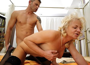 Naughty mature lady fucking her ass off