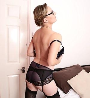 Naughty British mature lady playing with herself