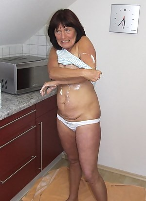kinky mama playing with some whipped cream