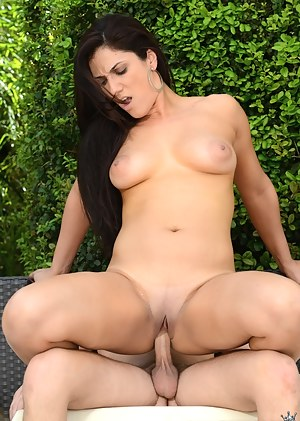 Welcome to picturesque garden where sweet brunette woman is fucking with her young partner. She is riding his big cock with pleasure.