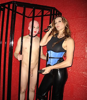 Jane lets her slave out of the cage and then fucks him