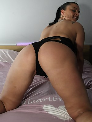 Big breasted MILF playing alone