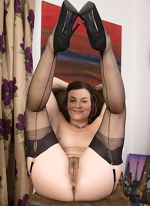 38 year old Sofia from AllOver30 showing off her ass and black stockings
