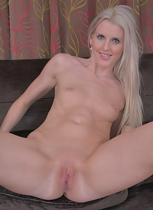 Blonde amateur Lexi Lou spreads her shaved pussy lips.