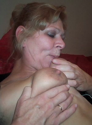 Mature couple having sex on their bed