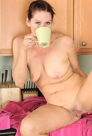 39 year old housewife Xena spreads while enjoying her coffee in here