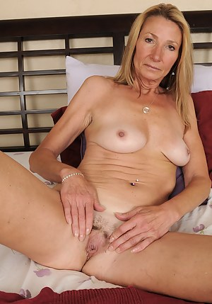 56 year old housewife Pam posing in and out of her sexy blue lingerie