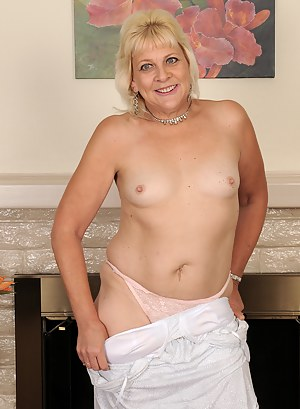 53 year old Sindy Silver from AllOver30 removes her lingerie and spreads