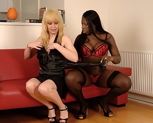 Lovely British ebony babe Melvina Raquel felt really horny one afternoon. Knowing her tranny pornstar friend Joanna Jet was staying locally, she thought she'd call her up and see if she fancied coming round to fuck the tits off her