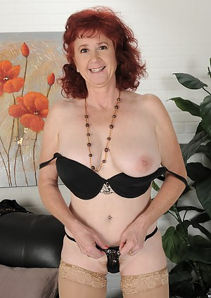 50 year old Surely from AllOver30 elegantly gets naked just for you