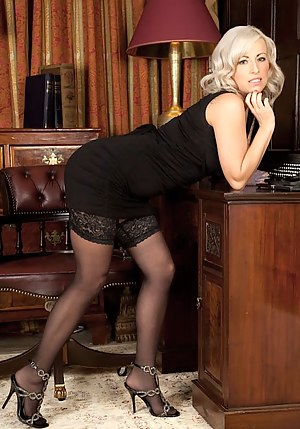 Blonde MILF Charlie Z spreads her stocking covered legs.