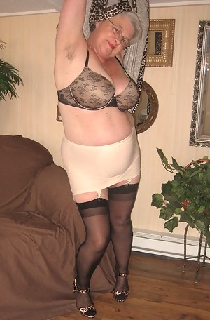 Long sexy leopard dress, and Girdlegoddess, is very seductive. Have a look under my dress and see my open bottom girdle,