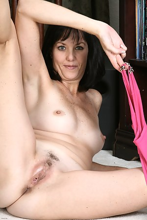 Horny 40 year old Sydney driving a glass dildo deep into her pussy