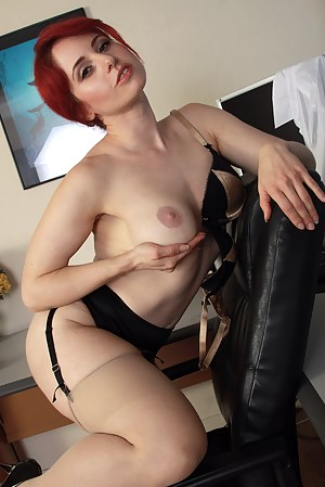Horny red headed office MILF Andrea Rosu plays with her shaven pussy