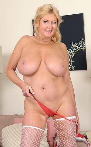 Mature and busty Tahnee Taylor breaks from her hard housework