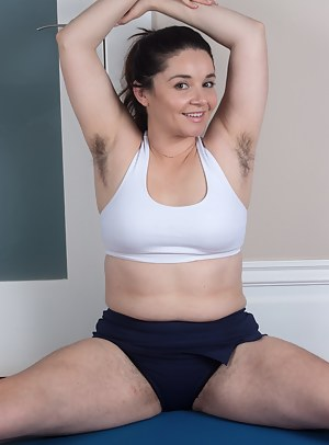 Hairy woman Maxine Holloway is a bbw but she also enjoys working out. She loves getting on her blue mat, stretching and warming up. She slowly strips and works her hairy pussy out as well.