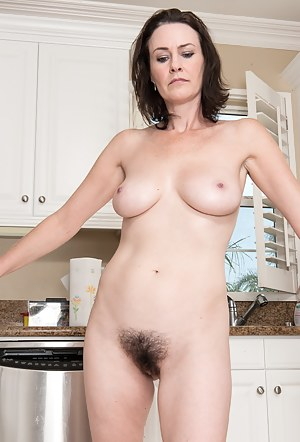 Hairy woman Veronica Snow is in the kitchen in the afternoon when she gets hot and strips out of her clothes showing off her teal panties and then she removes them to show off her hairy pussy.